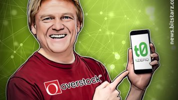 Patrick-Byrne-wearing-an-Overstock-branded-t-shirt-trading-crypto-on-a-phone